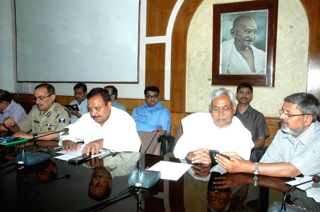 Bihar Chief Minister Nitish Kumar during a meeting with top officials regarding the damage caused by the earthquake in the state; in Patna on April 26, 2015.