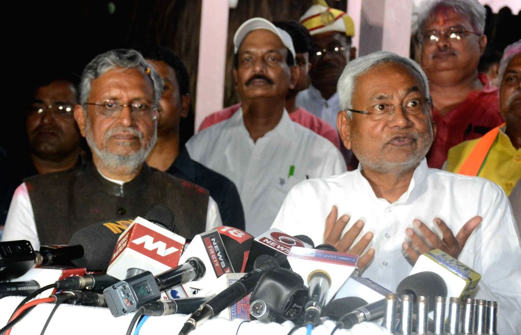 Patna: Bihar Chief Minister Nitish Kumar talks to press after the BJP-led NDA is set to retain power for another five years after making a sweep of the 2019 Lok Sabha battle and mauling the opposition; in Patna on May 23, 2019. Also seen Bihar Deputy - Nitish Kumar and Sushil Kumar Modi