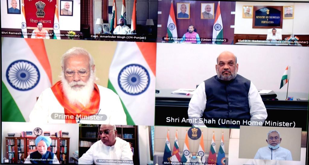 Patna:  Bihar Chief Minister Nitish Kumar via video conferencing Prime Minister Narendra Modi attend a meeting of high level committee to commemorate 400th birth anniversary of Sri Guru Tegh Bahadur, In Patna on Thursday April 08,2021. (Photo: Indraj - Nitish Kumar and Narendra Modi