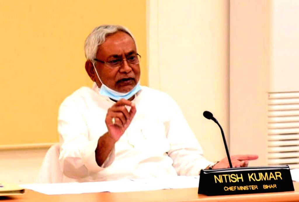 Patna: Bihar Chief Minister Nitsih Kumar joins Prime Minister Naredra Modi as he launches the 'Ghar Tak Fibre' Scheme and lays the foundation stone for 9 highway projects in Bihar, via video conferencing from Patna on Sep 21, 2020. (Photo: IANS) - Nitsih Kumar and Naredra Modi