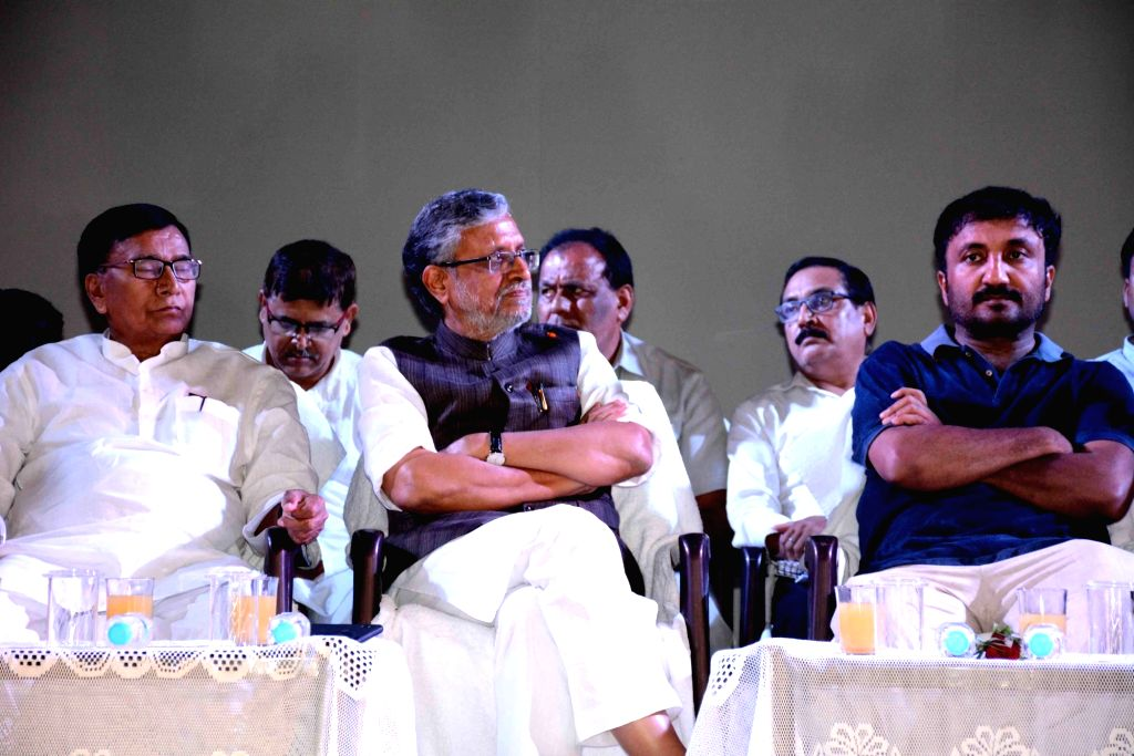 """Patna: Bihar Deputy Chief Minister Sushil Kumar Modi and Super 30's founder and mathematician Anand Kumar during a programme organised to felicitation actors of """"Super 30"""" in Patna on July 18, 2019. (Photo: IANS) - Sushil Kumar Modi and Anand Kumar"""