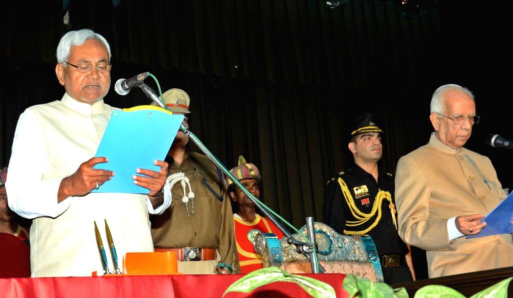 Bihar Governor Keshari Nath Tripathi administers oath of office to Bihar Chief Minister designate Nitish Kumar during a swearing-in ceremony at Raj Bhavan in Patna, on Feb 22, 2015. - Keshari Nath Tripathi