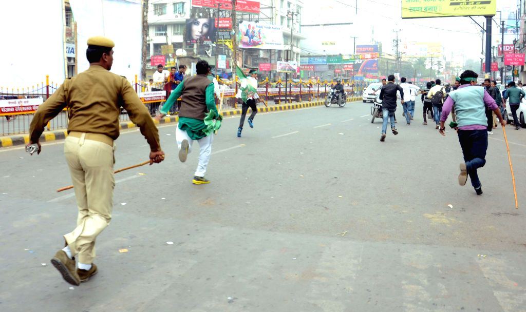 Bihar Police personnel lathi charge students during their demand demonstration for Patna University Students Union (PUSU) elections in Patna on Feb 5, 2015.