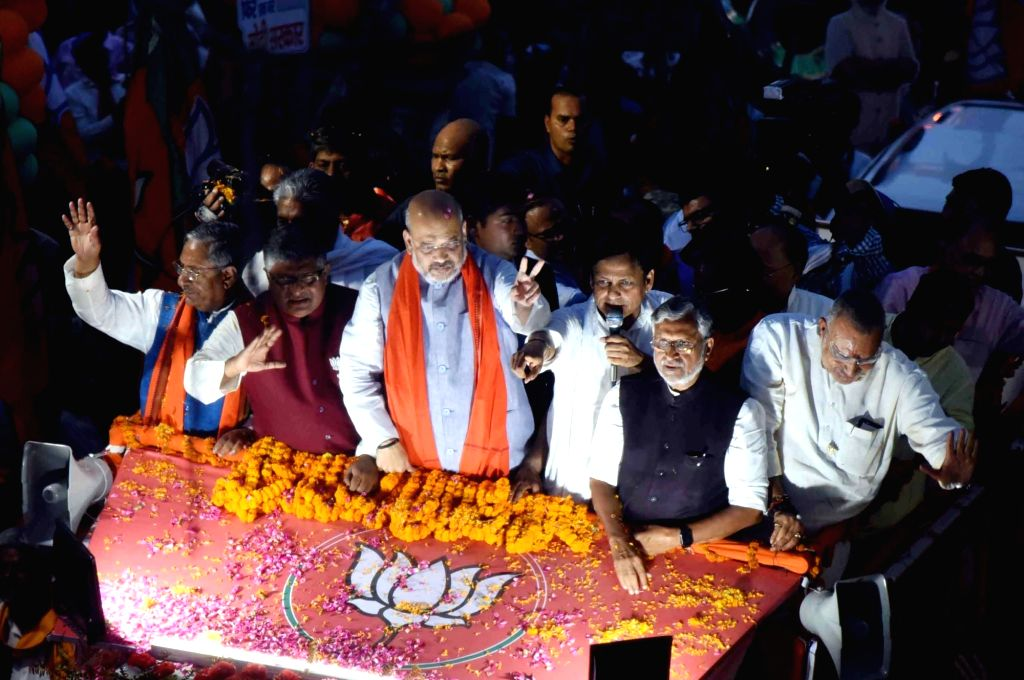 Patna: BJP chief Amit Shah accompanied by Bihar Minister Nand Kishore Yadav, Union Ministers Ravi Shankar Prasad and Giriraj Singh, Bihar party President Nityanand Rai and the state's Deputy Chief Minister Sushil Kumar Modi during a roadshow ahead of - Nand Kishore Yadav, Ravi Shankar Prasad, Giriraj Singh, Amit Shah, Nityanand Rai and Sushil Kumar Modi