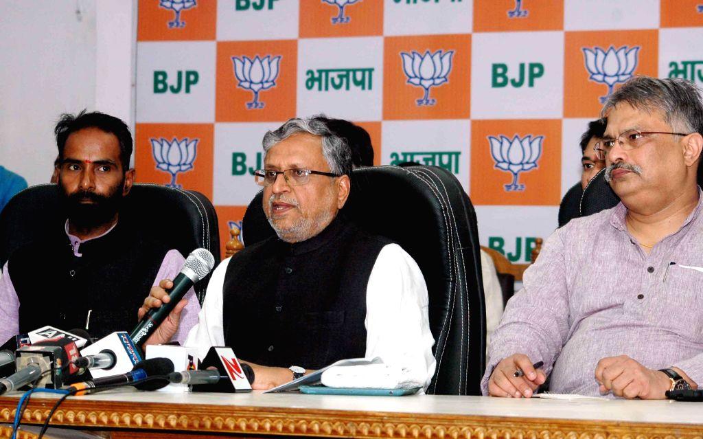 BJP leader Sushil Kumar Modi addresses a press conference in Patna, on Nov 6, 2014.