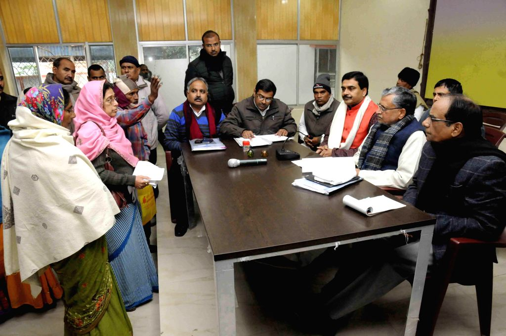 BJP leader Sushil Kumar Modi interacts with people at Janata Darbar in Patna, on Dec 30, 2014.