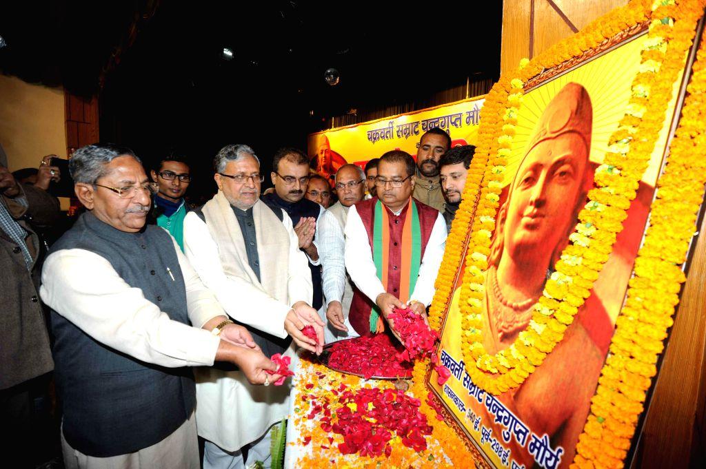 BJP leader Sushil Kumar Modi pays tribute to Chandragupta Maurya - the founder of the Maurya Empire during a programme in Patna on Dec 9, 2014. - Sushil Kumar Modi