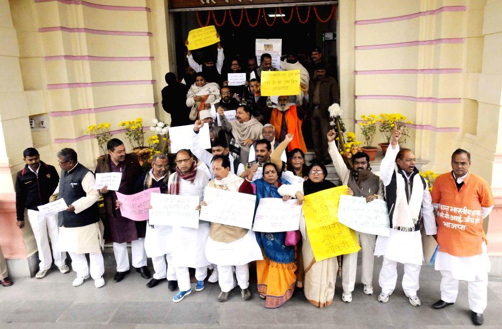 BJP legislators stage a demonstration at the Bihar Assembly premises in Patna, on Dec 22, 2014.