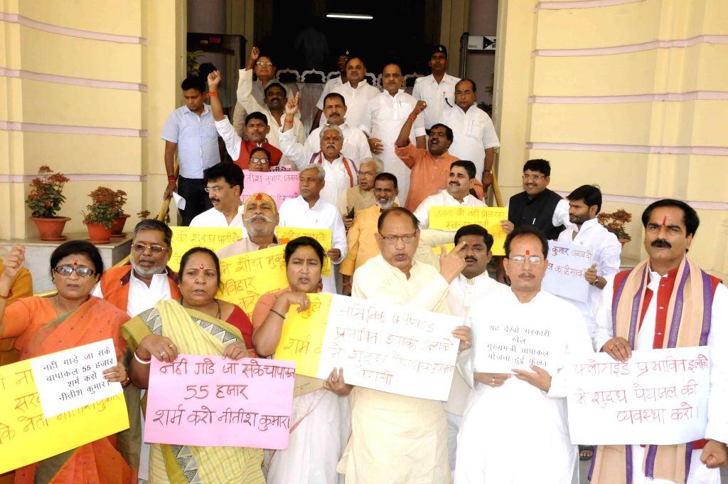 BJP legislators stage a demonstration at Bihar assembly in Patna, on April 9, 2015.