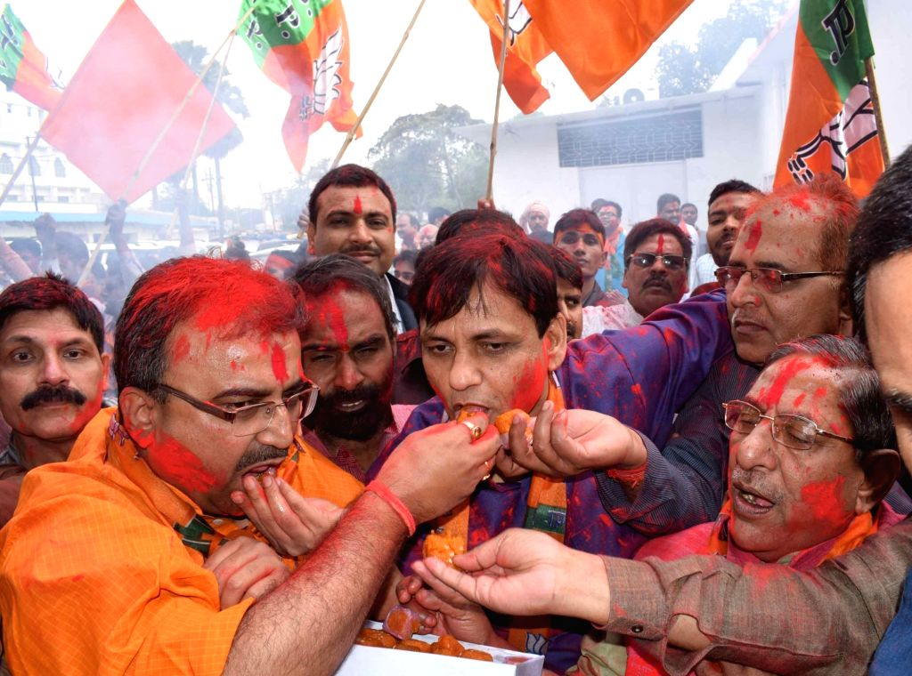 :Patna: BJP supporters celebrate party's performance in the assembly elections in Patna on March 11, 2017. (Photo: IANS).