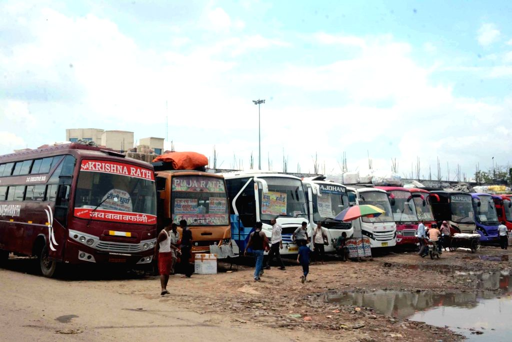 Patna: Buses remain parked at a Mithapur Bus Stand during a strike called by All India Coordination Committee of Road Transport Workers' Organisations against Motor Vehicles (Amendment) Bill in Patna on Aug 7, 2018. (Photo: IANS)
