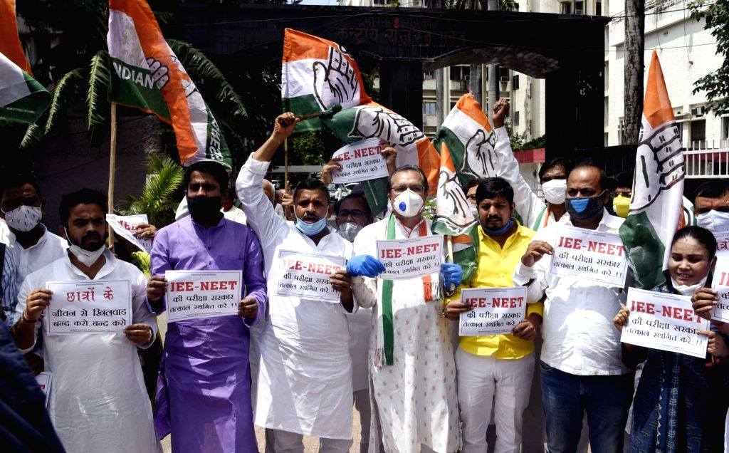Patna: Congress activists stage a demonstration demanding the postponement of National Eligibility-cum-Entrance Test (NEET) and Joint Entrance Exam (JEE) in the wake of the COVID-19 pandemic, in Patna on Aug 28, 2020. (Photo: IANS)