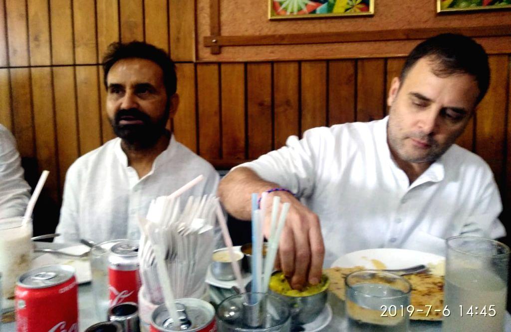Patna: Congress leader Rahul Gandhi relishes Masala Dosa at a restaurant in Patna on July 6, 2019. (Photo: IANS) - Rahul Gandhi