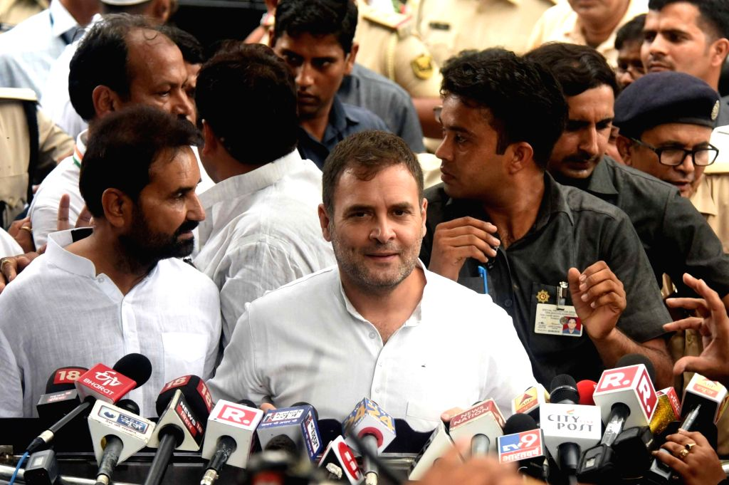 Patna: Congress President Rahul Gandhi talks to media personnel after he was granted bail by a court in connection with a defamation case filed by Bihar Deputy Chief Minister Sushil Kumar Modi, in Patna on July 6, 2019. (Photo: IANS) - Sushil Kumar Modi and Rahul Gandhi