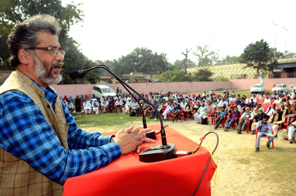 CPI(ML) general secretary Dipankar Bhattacharya addresses during a programme organised in Patna, on Feb 15, 2015.