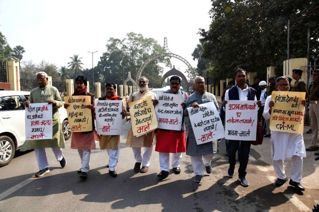Patna : CPI-ML legislators staged a protest outside Bihar Vidhan Sabha, Patna on February 22, 2021.