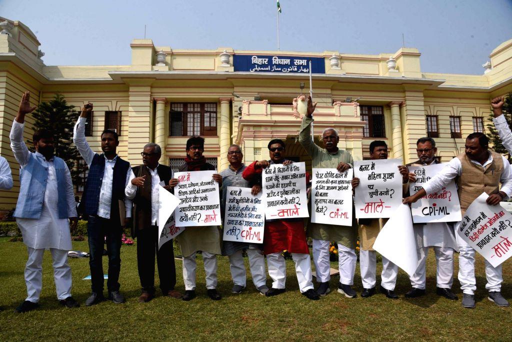 Patna : CPI-ML legislators staged a protest outside Bihar Vidhan Sabha, Patna on February 23, 2021.