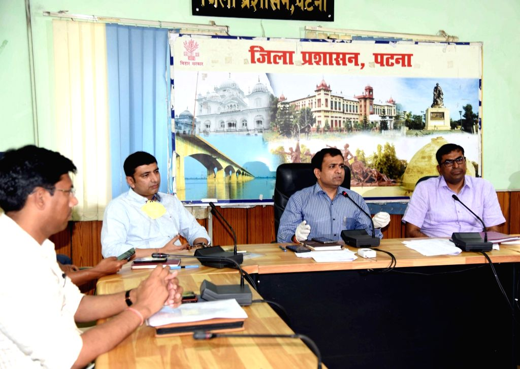 Patna Divisional Commissioner Sanjay Kumar Agarwal and District Magistrate Kumar Ravi chair a meeting on COVID-19 on Day 4 of the lockdown imposed in the wake of the coronavirus pandemic, in Patna on ... - Magistrate Kumar Ravi