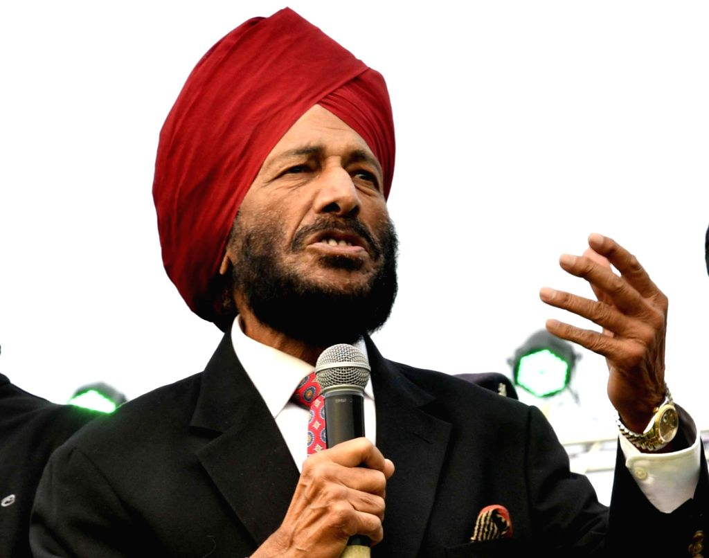 Patna: Former Indian track and field athlete Milkha Singh addresses during 'Patna Marathon 2017' at Gandhi Maidan on Dec 17, 2017. (Photo: IANS) - Milkha Singh