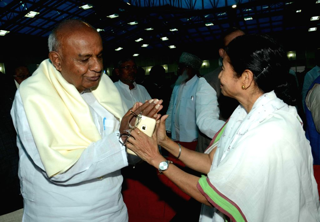 Former prime minister and JD (S) chief H D Deve Gowda and West Bengal Chief Minister Mamata Banerjee during JD(U) leader Nitish Kumar's swearing-in ceremony as the chief minister of Bihar at ...