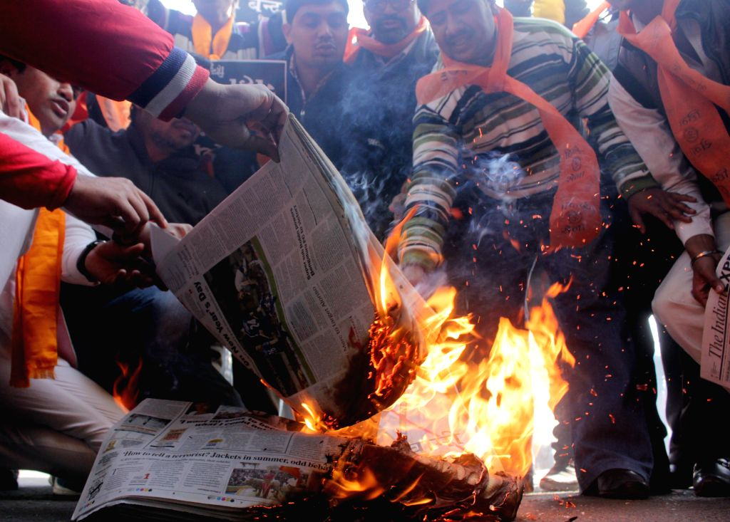 Hindu Sena activists stage a demonstration outside the office of Indian Express in New Delhi, on Jan 5, 2015.