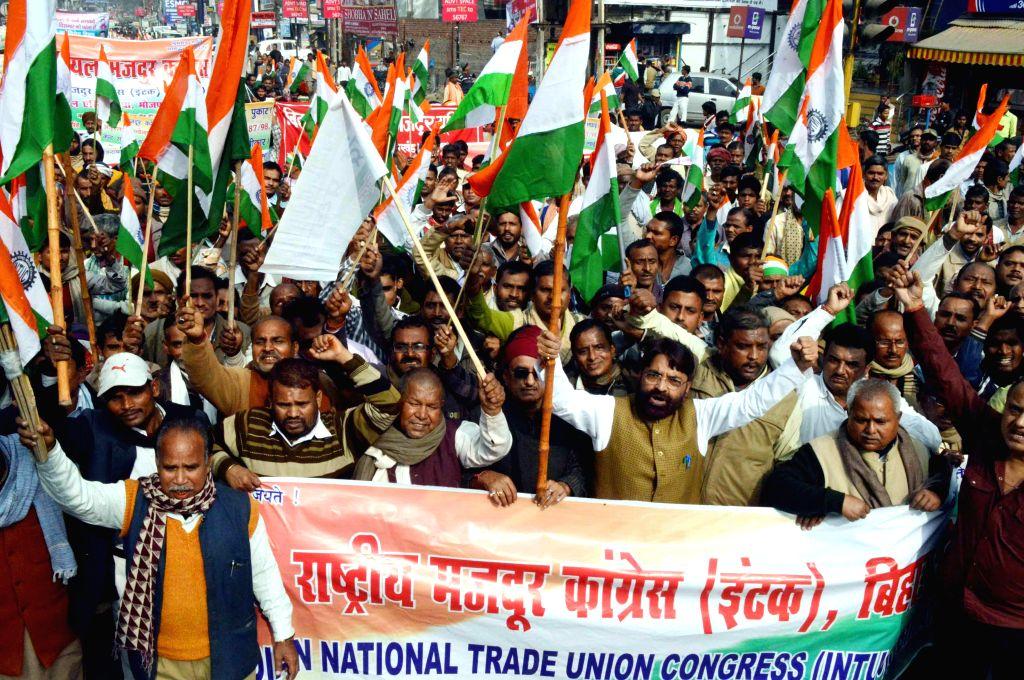 Indian National Trade Union Congress (INTUC) members stage a demonstration to press for their demands in Patna on Dec 5, 2014.