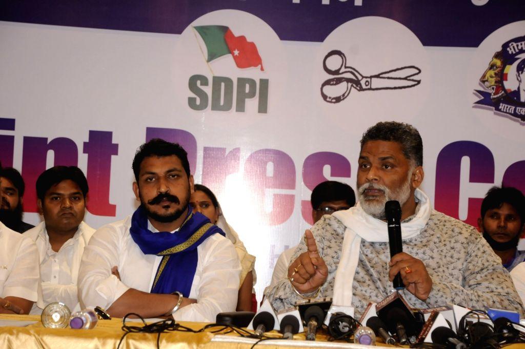 Patna: Jan Adhikar Party (JAP) chief Pappu Yadav and Bhim Army chief Chandrashekhar Azad hold a joint press conference ahead of Bihar Assembly elections, in Patna on Oct 14, 2020. (Photo: IANS) - Pappu Yadav