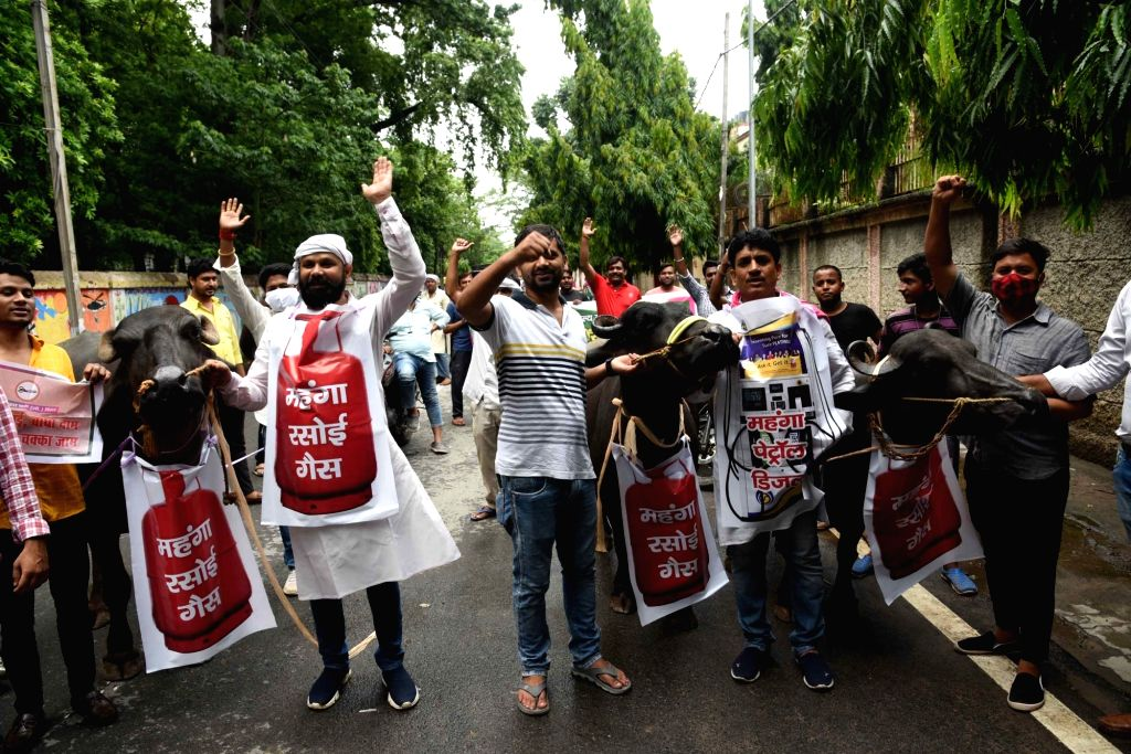 Patna :  Jan Adhikar Party party activists participate in Buffallow rally to protest against the hike of prices of petroleum products in Patna on Sunday, June 20 2021.