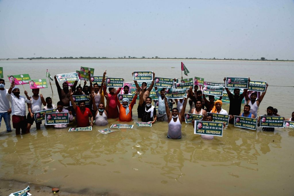 Patna : Jan Adhikar Party workers hold placards during the Jal Satyagrah for their demands of release Party president Pappu Yadav at river Ganga in Patna on Tuesday 08 June 2021. - Pappu Yadav