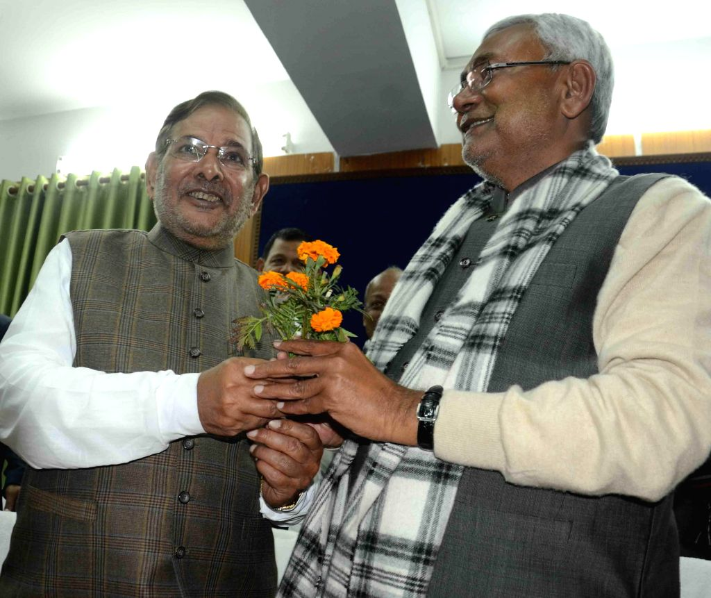 JD(U) chief Sharad Yadav congratulates party leader Nitish Kumar who was elected the new leader of the JD-U legislature party in Bihar, in Patna, on Feb 7, 2015. - Sharad Yadav