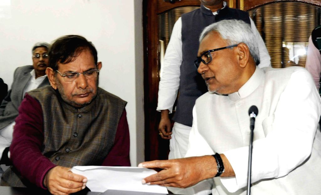JD (U) chief Sharad Yadav with Janata Dal (United) leader Nitish Kumar during a party worker meeting in Patna on Feb. 4, 2015.