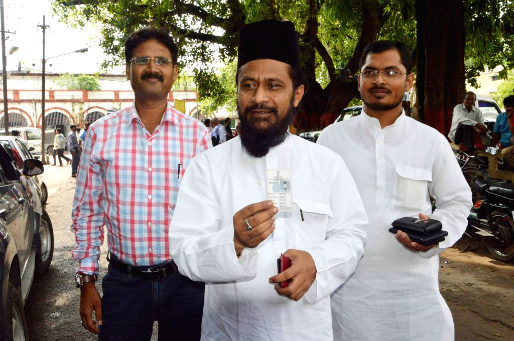 Patna: JD(U) leader Ghulam Rasool Balyawi arrives to cast his vote during the Vidhan Parishad elections in Patna on July 7, 2015. (Photo: IANS)