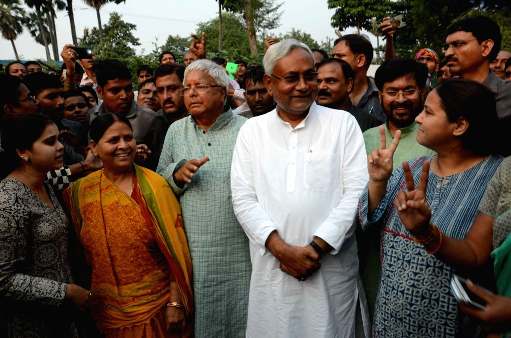 :Patna: JD(U) leader Nitish Kumar with RJD leaders Lalu Prasad Yadav, Rabri Devi, Misa Bharti and others after the victory of Grand Alliance in the recently concluded Bihar polls in Patna, on Nov ... - Nitish Kumar