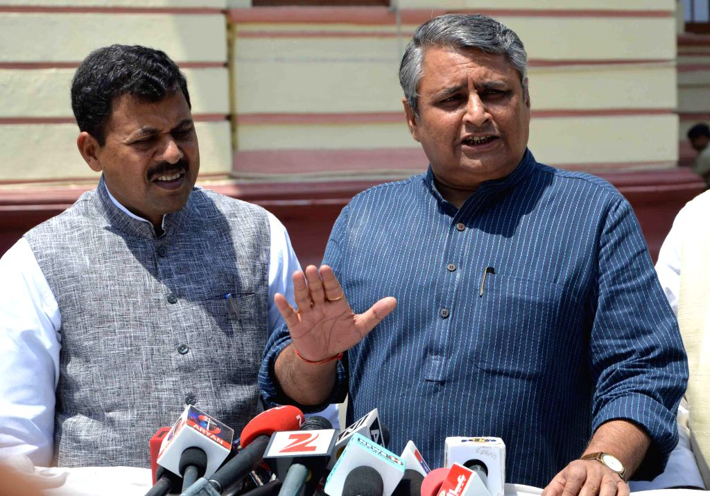 JD(U) leader Vijay Chaudhary addresses press at the Bihar assembly in Patna, on April 8, 2015.