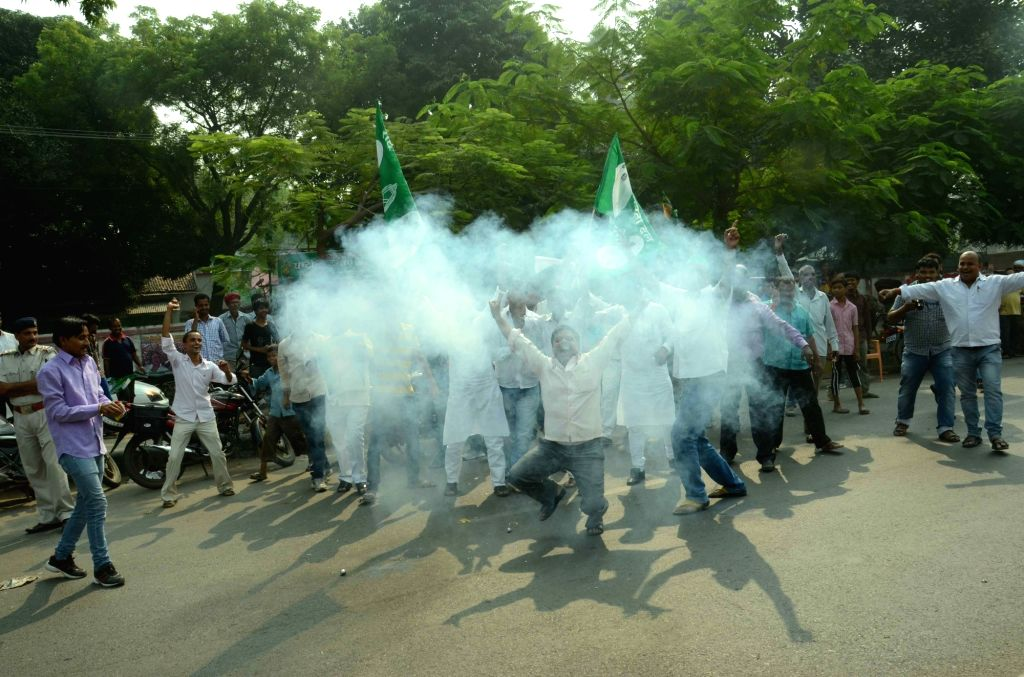 :Patna: JD(U) workers celebrate party's performance in the recently concluded Bihar assembly polls in Patna on Nov 8, 2015. (Photo: IANS). - Nitish Kumar