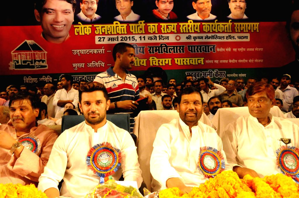 LJP chief and Union Minister for Consumer Affairs, Food and Public Distribution Ramvilas Paswan, during a party programme in Patna  on March 27, 2015. Also seen party MP Chirag Paswan and ...