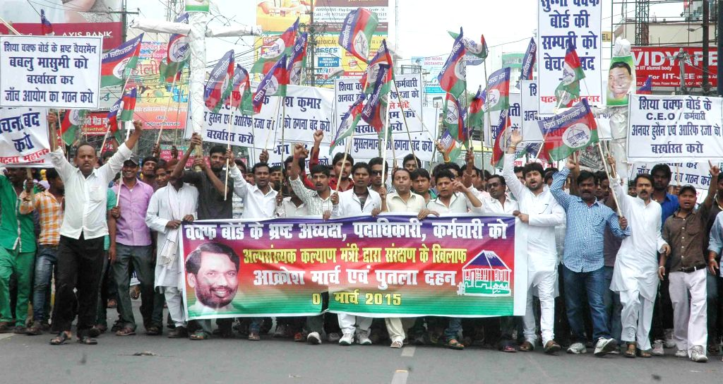 LJP leaders stage a demonstration against Waqf board in Patna on March 16, 2015.
