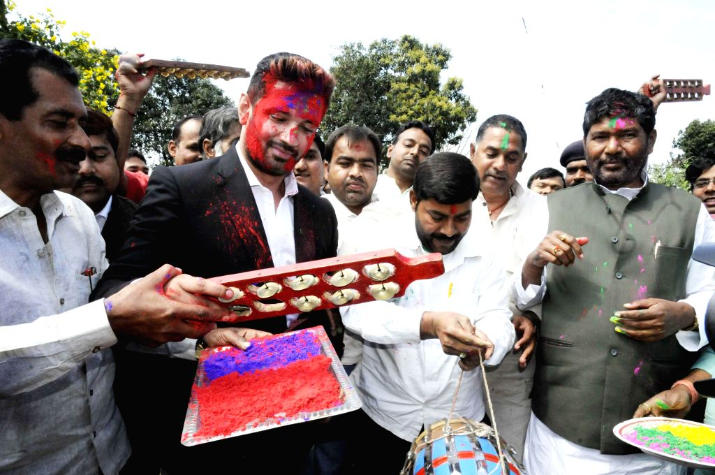 LJP MP Chirag Paswan celebrates Holi with party workers in Patna on March 4, 2015.