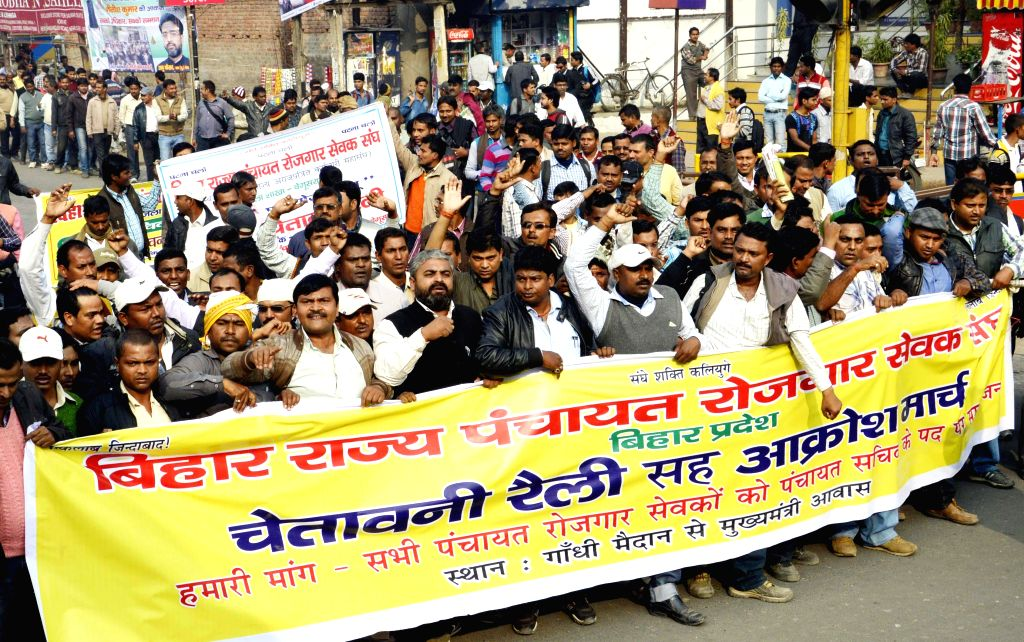 Members of Bihar Panchayat Rozgar Sangh stage a demonstration to press for their various demands in Patna on Dec 1, 2014.