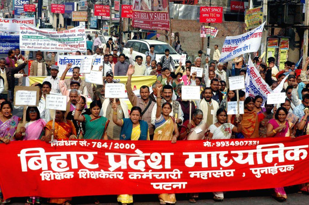 Members of `Bihar Pradesh Madhyamik Sikshak Sangh` stage a demonstration to press for their demands in Patna on Nov 19, 2014.