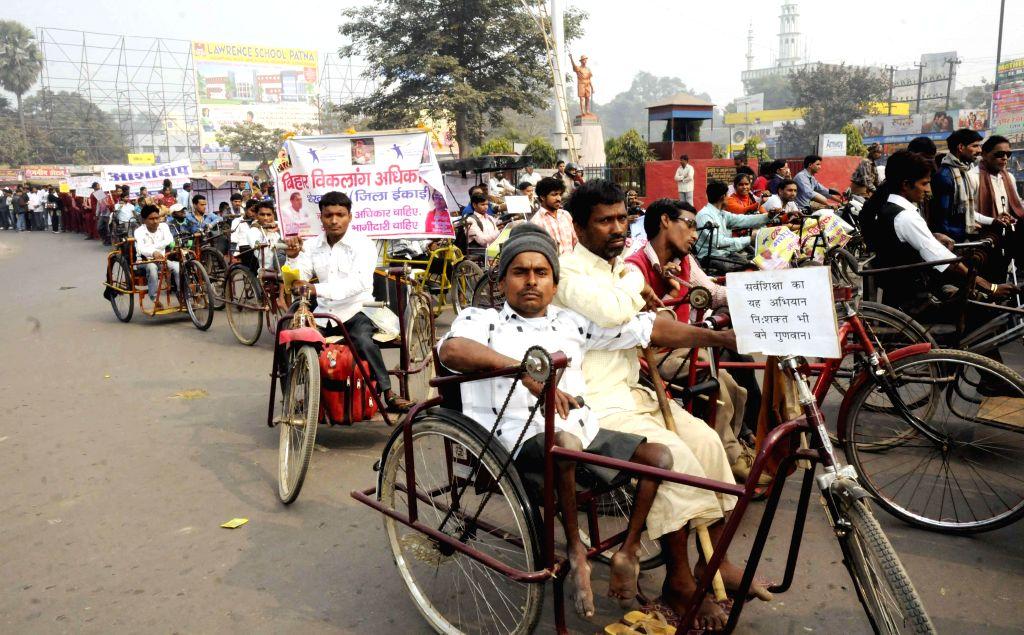 Members of `Bihar Viklang Adhikar Manch` participate in a rally to press for their demands in Patna on Dec 2, 2014.