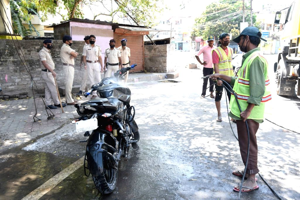Patna Municipality workers spray disinfectents across different areas of the city on Day 2 of the 21-day nationwide lockdown imposed by the Narendra Modi government over the coronavirus ... - Narendra Modi