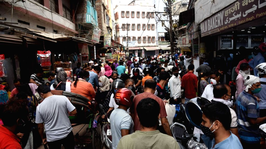 Patna :  Muslims devotees ignoring social distancing norms at a crowded market on the eve of Eid-al-Fitr Festival amid a COVID-19 lockdown in in Patna  on Thursday  13 May 13,2021.