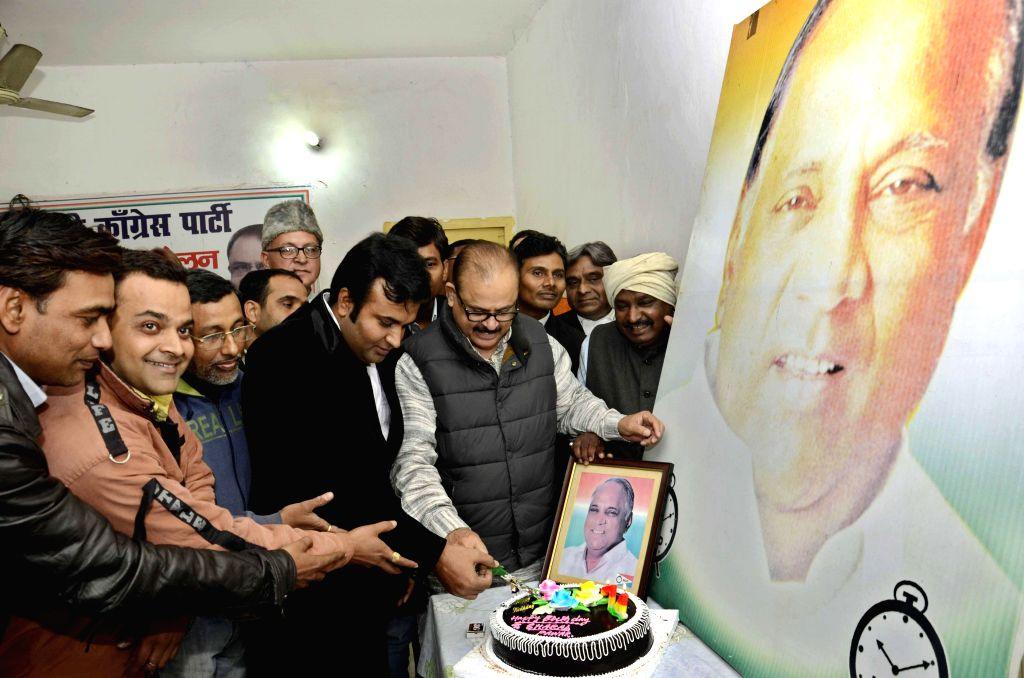 NCP workers celebrate party chief Sharad Pawar's birthday in Patna, on Dec 12, 2014.