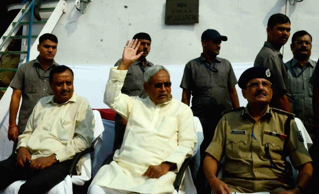 :Patna:  Nitish Kumar inspects preparations for Chhath Puja in Patna on Nov 12, 2015. (Photo: IANS). - Nitish Kumar and Sonia Gandhi