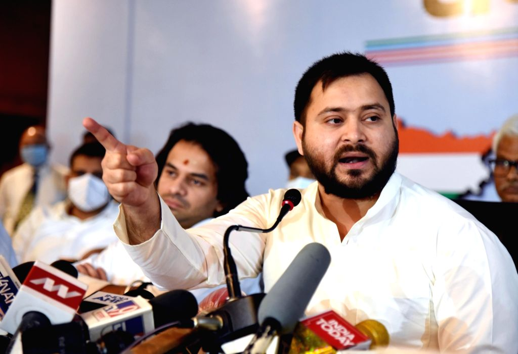 Patna, Oct 7 (IANS) RJD leader Tejashwi Yadav has urged Bihar Chief Minister Nitish Kumar to recommend a CBI inquiry in the murder case of Dalit leader Shakti Singh. - Nitish Kumar, Tejashwi Yadav and Singh