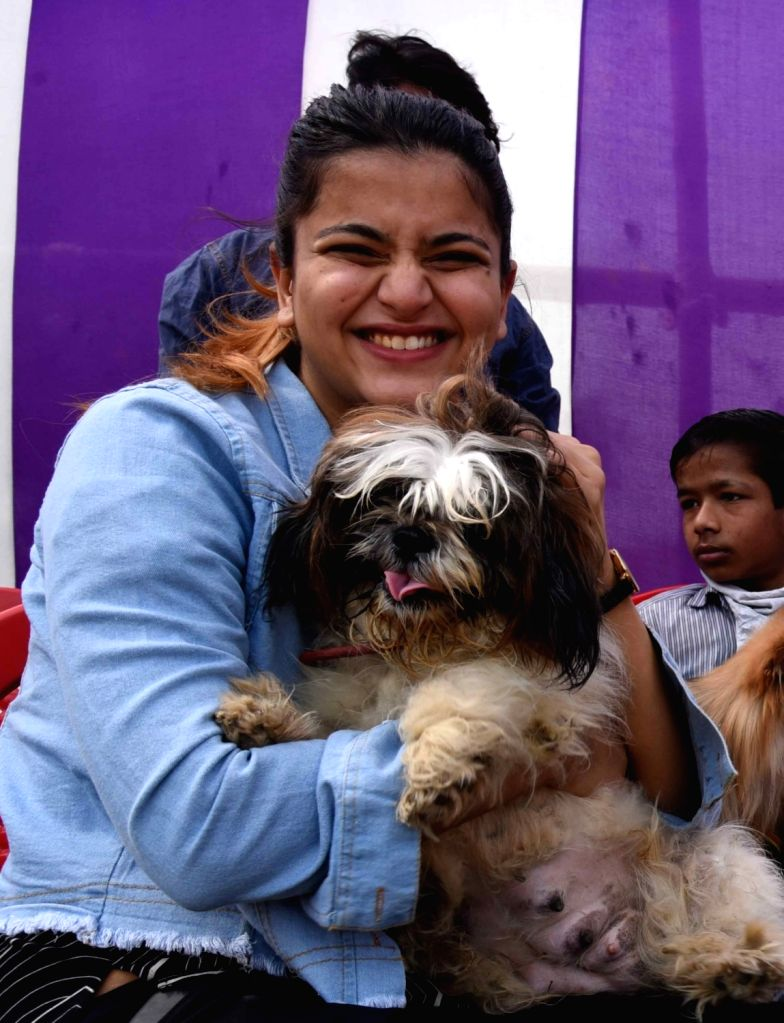 Patna : Participants hold their pets during a Dog Show competition at Bihar Veterinary College in Patna on Sunday February 21,2021 .