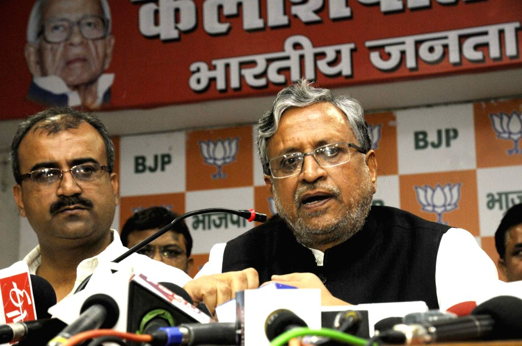 Patna: Patna: BJP leader Sushil Kumar Modi addresses a press conference in Patna on August 1, 2015. Also seen Bihar BJP chief Mangal Pandey. - Mangal Pandey