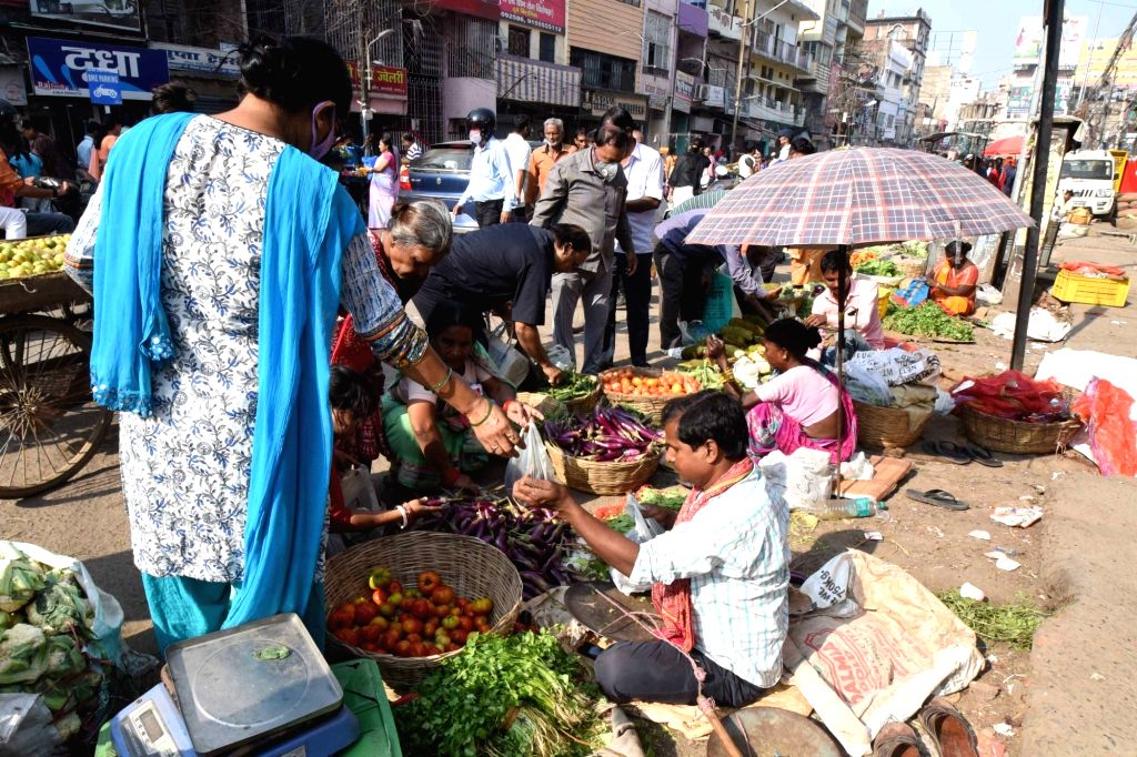 Patna: People busy buying vegetables during complete lockdown imposed in 560 districts in 32 states and union territories across the country as precautionary measures to contain the spread of the coronavirus, in Patna on Mach 24, 2020. (Photo: IANS)