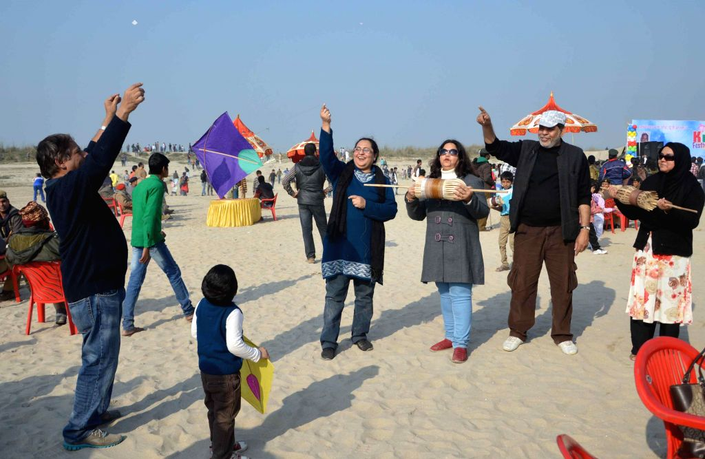 People fly kites on Makar Sankranti in Patna, on Jan 14, 2015.
